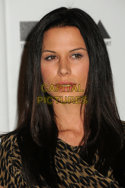 "RHONA MITRA .attending MOCA's Annual Gala, ""The Artist's Museum Happening"", Sponsored by Chanel Fine Jewelry, held at MOCA Grand Avenue (Museum Of Contemporary Art) in Los Angeles, California, USA, November 13th 2010. .portrait headshot gold khaki black print .CAP/ADM/BP.©Byron Purvis/AdMedia/Capital Pictures."