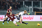Jerdy Schouten of Bologna is hauled down by Diego Laxalt of Torino FC during the Serie A match at Stadio Grande Torino, Turin. Picture date: 12th January 2020. Picture credit should read: Jonathan Moscrop/Sportimage