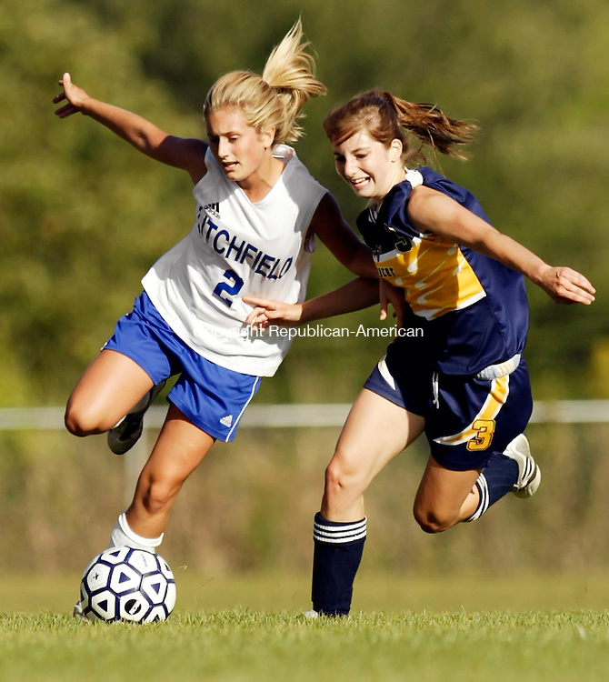 LITCHFIELD, CT - 19 September 2005 -091905JS02--Litchfield's Liz Binstadt (2) and Gilbert's Courtney Kane (3) battle for possession during their game Monday in Litchfield.   --Jim Shannon / Republican-American  -- Gilbert; Courtney Kane; Litchfield; Liz Binstadt are CQ