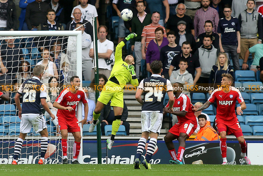 Chesterfield goalkeeper, Tommy Lee, makes a fine save to thwart the Millwall attack during Millwall vs Chesterfield, Sky Bet League 1 Football at The Den, London, England on 29/08/2015