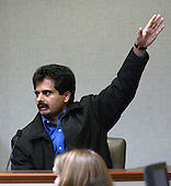 Maryland liquor store owner Muhammad Rashid gestures during his testimony in the trial of sniper suspect John Allen Muhammad in courtroom 10 at the Virginia Beach Circuit Court in Virginia Beach, Virginia, Wednesday October 22, 2003. Rashid testified about his being shot on September 15, 2002. <br /> Credit: Davis Turner - Pool via CNP