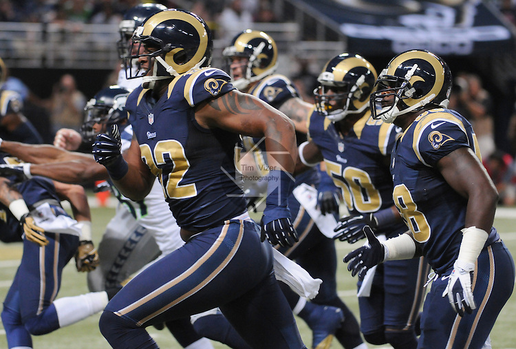 Football - NFL- Seattle Seahawks at St. Louis Rams.St. Louis Rams defensive end Eugene Sims (92) runs from the line of scrimmage with teammates at the Edward Jones Dome in their game against the Seattle Seahawks. The Rams defeated the Seahawks, 19-13.