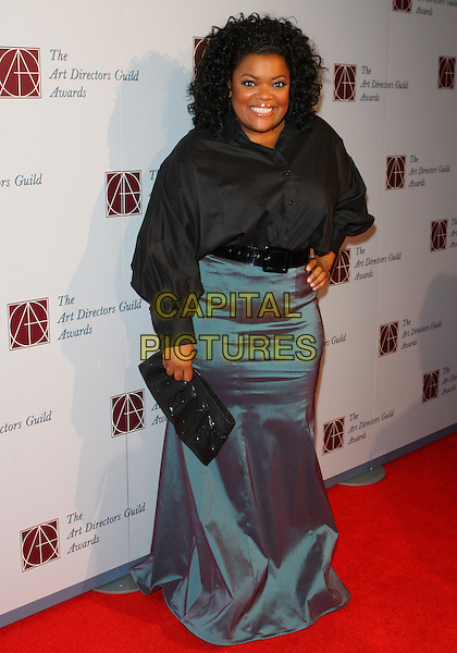 YVETTE NICOLE BROWN .15th Annual Art Directors Awards held at The Beverly Hilton Hotel, Beverly Hills, California, USA, .5th February 2011.full length silver long maxi green two tone skirt shirt black belt hand on hip clutch bag .CAP/ADM/TC.©T. Conrad/AdMedia/Capital Pictures.