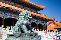 Lion statue in fornt of a temple at the Forbidden City in Beijing, China