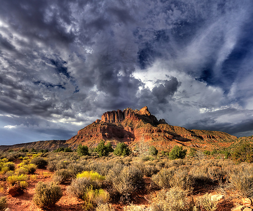 Dark and menacing clouds gather over Mount Kinesava at Zion National Park, Utah