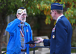 Nevada Adjutant General William R. Burks, right, honors Navy veteran Charles Sehe during a ceremony at the U.S.S. Nevada Memorial on the Capitol grounds in Carson City, Nev., on Wednesday, Oct. 14, 2015. Sehe served on the U.S.S. Nevada during World War II. (Cathleen Allison/Las Vegas Review-Journal)