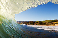 A surfers view of the gaviota coast through a wave