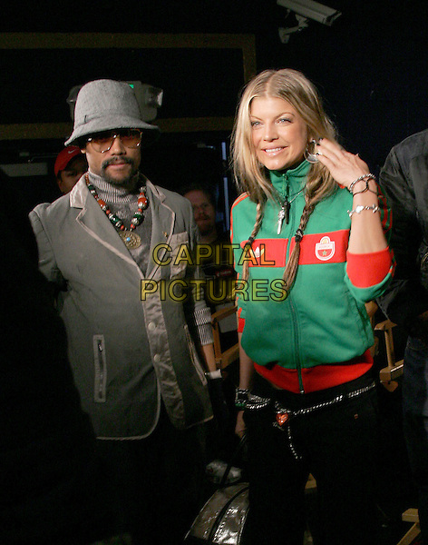 BLACK EYED PEAS - FERGIE & APL.DE.AP .The 47th Annual Grammy Award Nominees Announcements. The announcements were held at The Music Box in Hollywood, California .December 7th, 2004.half length, green zip up top, cardigan, hat, braids, plaits, touching har.www.capitalpictures.com.sales@capitalpictures.com.Supplied By Capital PIctures