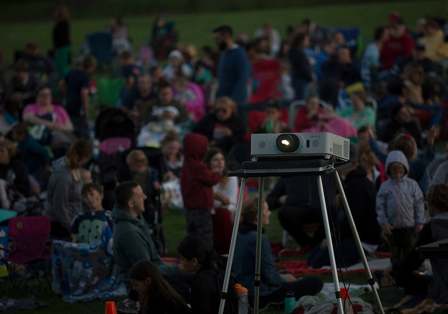 Families and other members of the public sprawl out on picnic blankets and portable chairs to watch a movie in Marshall Park in Vancouver Friday July 15, 2016. A star wars movie was shown on the lawn following a Seahawks event. (Photo by Natalie Behring/ for the The Columbian)