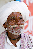 Portrait of local Hindu man in turban, small village of Charu near Ranthambore, Rajasthan, India