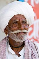 Portrait of local Hindu man in turban, small village of Charu near Ranthambore, Rajasthan, India
