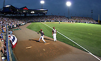 Stephen Richards (49) warms up in the Arkansas Razorbacks' bullpen during a 2009 College World Series game at Rosenblatt Stadium in Omaha. Also pictured is Scott Limbocker (36). (Photo by Michelle Bishop)