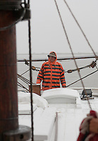 Captain, navigating the Historic Tall Ship, A.J. Meerwald, sailing on the Delaware Bay, New Jersey