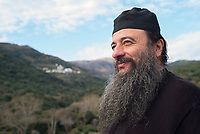 Mount Athos - The Holy Mountain.<br /> A monk looks out over Mount Athos. <br /> <br /> Photographer: Rick Findler