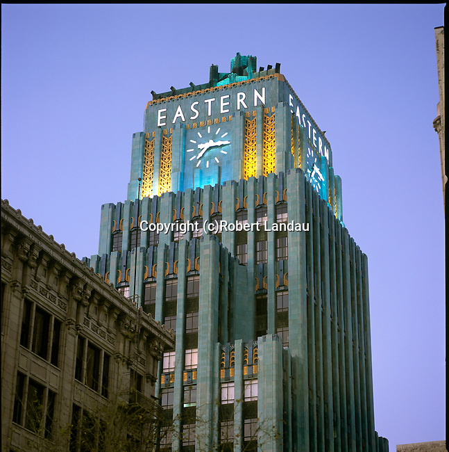 The Art Deco Eastern Building in downtown Los Angeles with lit tower at night.