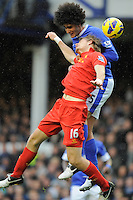 28.10.2012 Liverpool, England.  Marouane Fellaini  of Everton wins a header from Sebastian Coates of Liverpool    during the Premier League game between Everton and Liverpool  from Goodison Park ,Liverpool