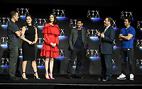 LAS VEGAS, NV - APRIL 24: (L-R) Director Peter Berg, actors Ronda Rousey, Lauren Cohan, Iko Uwais, Chairman of STXfilms Adam Fogelson and actor Mark Wahlberg onstage during the STX Films presentation at CinemaCon 2018 at The Colosseum at Caesars Palace on April 24, 2018 in Las Vegas, Nevada. (Photo by Frank Micelotta/PictureGroup)