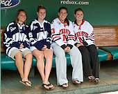 Courtney Sheary (UNH - player), Micaela Long (UNH - player), Lindsay Berman (Northeastern - player) and Annie Hogan (Northeastern - Co-Captain) pose in the Red Sox dugout.  A press conference hosted by the Hockey East Association, the Boston Red Sox and Fenway Sports Group was held on Thursday, August 20, 2009, at Fenway Park in Boston, MA, to announce that there would be a Hockey East college hockey doubleheader on Friday, January 8, 2010, held on the ice that will be used for the January 1, 2010 NHL Winter Classic.  The afternoon (4:00 pm EST) match will be between the Northeastern University Huskies (home team) and University of New Hampshire Wildcats women's teams while the evening (7:30 pm EST) match will be between the Boston College Eagles (home team) and the Boston University Terriers men's teams.