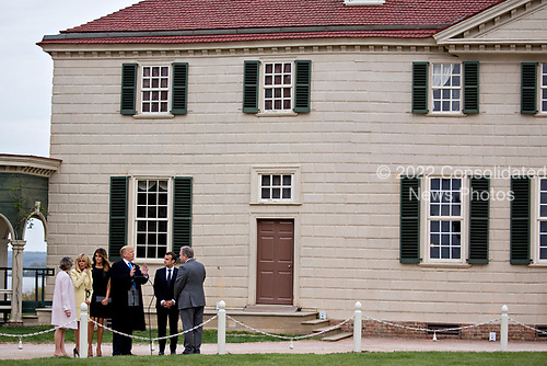 Doug Bradburn, president and chief executive officer of George Washington's Mount Vernon, from right, Emmanuel Macron, France's president, U.S. President Donald Trump, U.S. First Lady Melania Trump, Brigitte Macron, France's first lady, and Sarah Miller Coulson, regent with the Mount Vernon Ladies Association, tour outside the Mansion at the Mount Vernon estate of first U.S. President George Washington in Mount Vernon, Virginia, U.S., on Monday, April 23, 2018. As Macron arrives for the first state visit of Trump's presidency, the U.S. leader is threatening to upend the global trading system with tariffs on China, maybe Europe too. <br /> Credit: Andrew Harrer / Pool via CNP