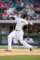 Jared Mitchell (9) of the Charlotte Knights follows through on his swing against the Norfolk Tides at BB&T BallPark on April 9, 2015 in Charlotte, North Carolina.  The Knights defeated the Tides 6-3.   (Brian Westerholt/Four Seam Images)