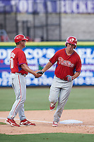 Philadelphia Phillies manager Pat Borders (10) congratulates Greg Pickett (28) after hitting a home run during an Instructional League game against the New York Yankees on September 27, 2016 at Bright House Field in Clearwater, Florida.  (Mike Janes/Four Seam Images)
