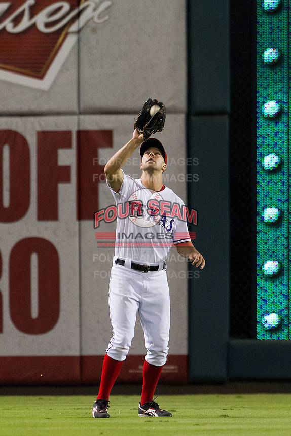 Texas Rangers outfielder David Murphy #7 makes a catch during the Major League Baseball game against the Baltimore Orioles on August 21st, 2012 at the Rangers Ballpark in Arlington, Texas. The Orioles defeated the Rangers 5-3. (Andrew Woolley/Four Seam Images).