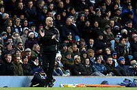 Manchester City manager Josep Guardiola shouts instructions to his team from the dug-out <br /> <br /> Photographer Rich Linley/CameraSport<br /> <br /> UEFA Champions League Group F - Manchester City v TSG 1899 Hoffenheim - Wednesday 12th December 2018 - The Etihad - Manchester<br />  <br /> World Copyright © 2018 CameraSport. All rights reserved. 43 Linden Ave. Countesthorpe. Leicester. England. LE8 5PG - Tel: +44 (0) 116 277 4147 - admin@camerasport.com - www.camerasport.com