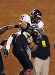 18 November 2006: Wake Forest's Josh Gattis (center) intercepts a pass thrown to Virginia Tech's Justin Harper (81). The Virginia Tech Hokies defeated the Wake Forest University Demon Deacons 27-6 at Groves Stadium in Winston-Salem, North Carolina in an Atlantic Coast Conference NCAA Division I College Football game.