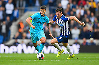 Erik Lamela of Tottenham Hotspur gets away from Lewis Dunk of Brighton and Hove Albion during Brighton & Hove Albion vs Tottenham Hotspur, Premier League Football at the American Express Community Stadium on 5th October 2019