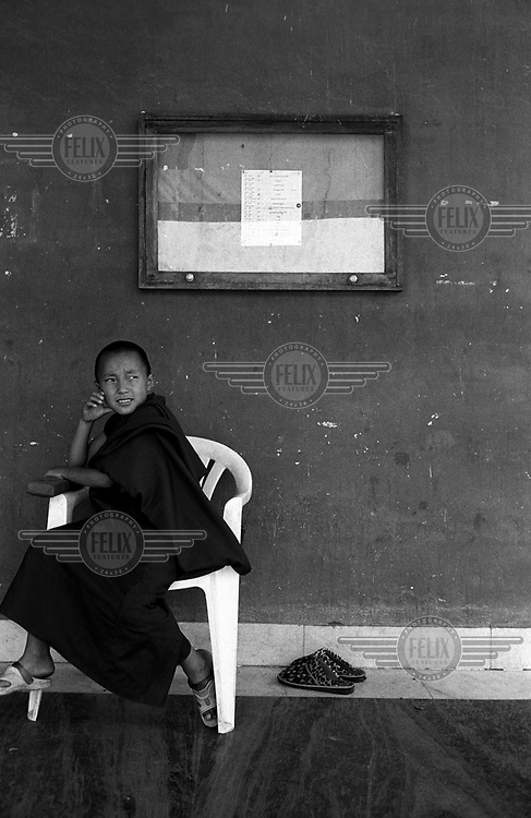 A young Tibetan Buddhist monk in Shechen monastery. About 300 monks live in the monastery, from a total of around 20,000 Tibetans living in exile in Nepal.