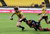 Jordie Barrett passes to his brother Beauden during the Super Rugby match between the Hurricanes and Highlanders at Westpac Stadium in Wellington, New Zealand on Saturday, 24 March 2018. Photo: Mike Moran / lintottphoto.co.nz