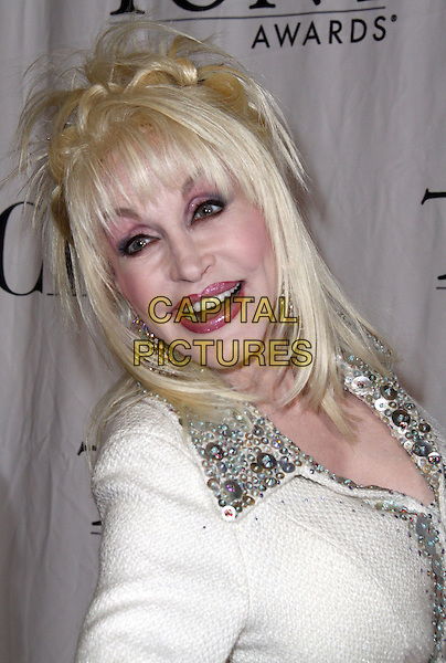 DOLLY PARTON .2009 Tony Awards - Meet the Nominees Press Reception held at the Millenium Broadway Hotel, New York, NY, USA, .6th May 2009..portrait headshot wig pink eyeshadow make-up lipstick white silver beaded collar .CAP/ADM/PZ.©Paul Zimmerman/Admedia/Capital Pictures