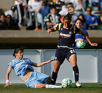 Jenny Hammond (2) of Sky Blue FC attempts a tackle on Camille Abily (20) of the Los Angeles Sol. The Los Angeles Sol defeated Sky Blue FC 2-0 during a Women's Professional Soccer match at TD Bank Ballpark in Bridgewater, NJ, on April 5, 2009. Photo by Howard C. Smith/isiphotos.com