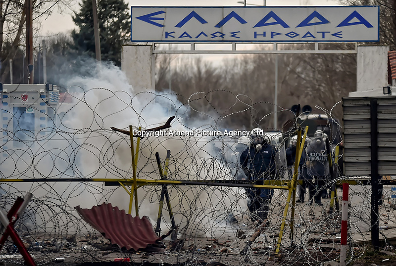 Pictured: Greek riot police as seen from the Turkish side of the border in Andrianoupolis. Sunday 01 March 2020<br /> Re: Clashes between migrants and riot police at the Greek-Turkish border of Kastanies near Evros, Greece