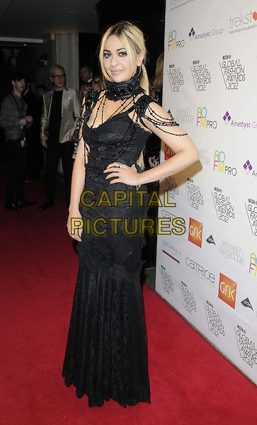 Zara Martin.The WGSN Global Fashion Awards, Savoy Hotel, The Strand, London, England..November 5th, 2012.full length black dress lace beads beaded scarf hand on hip.CAP/CAN.©Can Nguyen/Capital Pictures.