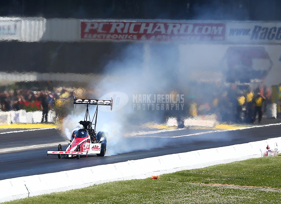 Jun. 1, 2014; Englishtown, NJ, USA; NHRA top fuel driver Steve Torrence during the Summernationals at Raceway Park. Mandatory Credit: Mark J. Rebilas-