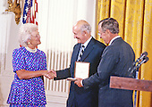 C. Douglas Dillon, American diplomat and politician, who served both as United States Ambassador to France and as the 57th Secretary of the Treasury, center, is awarded the Presidential Medal of Freedom, the highest civilian award of the United States, by US President George H.W. Bush, right, and first lady Barbara Bush, left, in a ceremony in the East Room of the White House in Washington, DC on July 6, 1989.  <br /> Credit: Ron Sachs / CNP