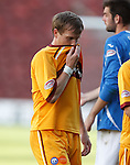 Steven Hammell pulls his  shirt over his face as his slack backpass led to St Johnstone's second goal