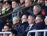 Archie Knox takes his behind Dundee chief exec Scot Gardiner in the directors box