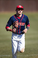 Shippensburg Raiders left fielder Grant Hoover (18) jogs off the field between innings of the game against the Belmont Abbey Crusaders at Abbey Yard on February 8, 2015 in Belmont, North Carolina.  The Raiders defeated the Crusaders 14-0.  (Brian Westerholt/Four Seam Images)
