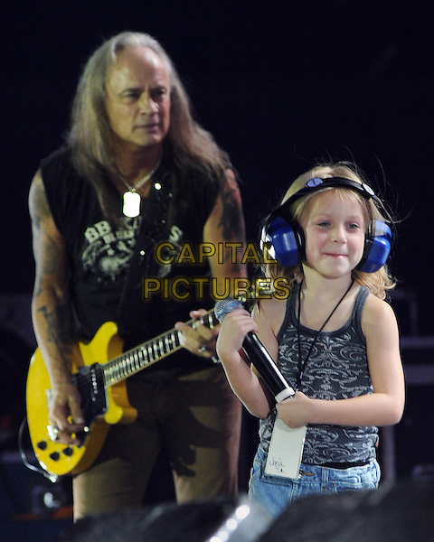 "RICKEY MEDLOCKE & JORJA BLEU MICHAELS .on stage during a stop of Lynyrd Skynyrd's ""God And Guns 2010"" tour with held at the First Niagara Pavilion, Pittsburgh, Pennsylvania, USA, .11th July 2010.   .music concert gig live half length guitar black vest sleeveless kid child earphones headphones                         .CAP/ADM/JN.©Jason L Nelson/AdMedia/Capital Pictures."