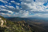 The Sandia Peak Tramway cables stretch a distance of 2.7 miles and elevate passengers four thousand vertical feet to the summit of Sandia Peak in about fifteen minutes.