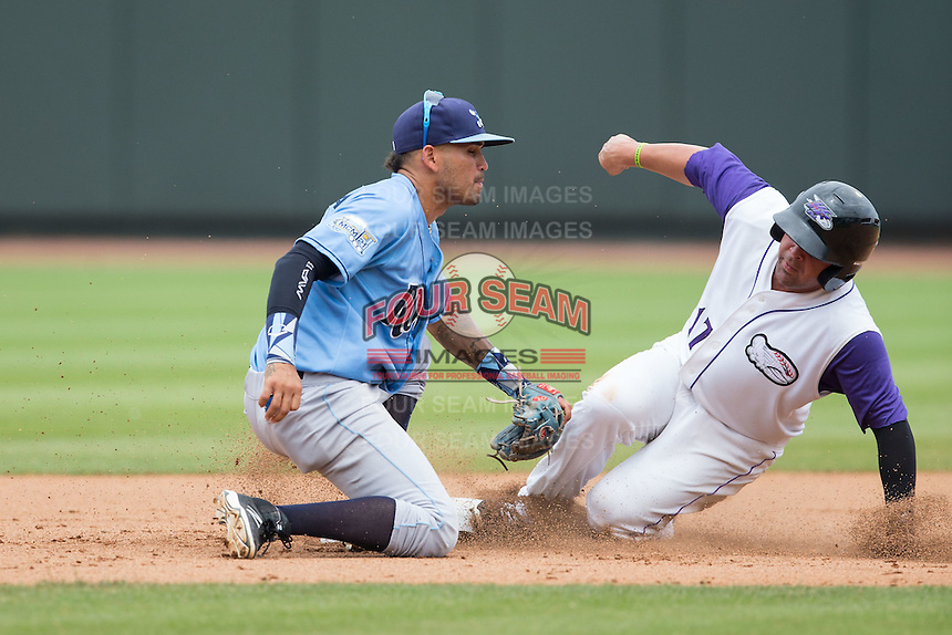 Gerson Montilla (17) of the Winston-Salem Dash steals second base ahead of the tag from Wilmington Blue Rocks shortstop Humberto Arteaga (23) at BB&T Ballpark on June 5, 2016 in Winston-Salem, North Carolina.  The Dash defeated the Blue Rocks 4-0.  (Brian Westerholt/Four Seam Images)
