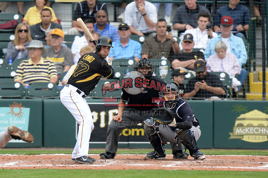 Outfielder Andrew Lambo (57) of the Pittsburgh Pirates at bat in front of Austin Romine and umpire Adrian Johnson during a spring training game against the New York Yankees on February 26, 2014 at McKechnie Field in Bradenton, Florida.  Pittsburgh defeated New York 6-5.  (Mike Janes/Four Seam Images)