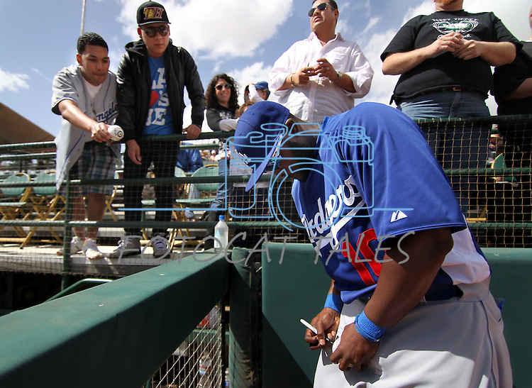 Dodgers' Tony Gwynn Jr. signs autographs before a Cactus League preseason game between the Dodgers and the A's in Scottsdale, Ariz., on Wednesday, March 7, 2012. The game ended 3-3..Photo by Cathleen Allison