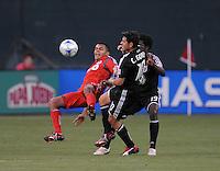 Toronto FC.  midfielder Amado Guevarra (20) gets fouled by DC United midfielder Christian Gomez (10).   DC United tied Toronto FC. 3-3 at  RFK Stadium, Saturday May 9, 2009.