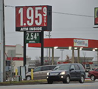 NWA Media/Michael Woods --12/19/2014-- w @NWAMICHAELW...Gas prices drop to a low of $1.95 a gallon Friday afternoon as travelers fill up their tanks at the Murphy Express on Highway 412 in Springdale.