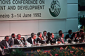 United Nations Conference on Environment and Development, Rio de Janeiro, Brazil, 3rd to 14th June 1992. The platform: l to r: Deputy Secretary-General of the Conference Nitin Desai, Secretqary-General Maurice Strong, UN Secretary General Boutros Boutros Ghali, Brazilian President Fernando Collor de Mello, Secretary of the Conference Miles Stoby, Chairman of the Main Committee Tommy Koh, and Rapporteur General Lakhdar Brahimi.