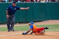 15 February 2009: Third base Yulieski Gourriel dives for a ball during a training game of Cuba Baseball Team for the World Baseball Classic 2009. The national team is pitted against itself, divided in two teams called the Occidentales and the Orientales. The Orientales win 12-8, at the Latinoamericano stadium, in la Habana, Cuba.