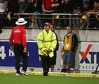 A steward picks a bottle off the pitch during 2nd Twenty20 cricket match match between New Zealand Black Caps and West Indies at Westpac Stadium, Wellington, New Zealand on Friday, 27 February 2009. Photo: Dave Lintott / lintottphoto.co.nz